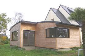 Exemple d'extension en ossature et bardage bois, toiture en zinc